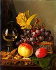 A Still Life of Black Grapes, a Peach, a Plum, Hazelnuts, a Metal Casket and a Wine Glass on a Carved Wooden Ledge